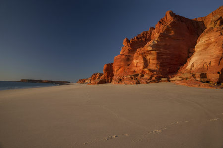 Western Australia rocky coastline with red colored rocks at Dampier Peninsula