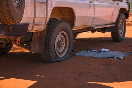 Fautly Tire on a sandy track in Western Australia