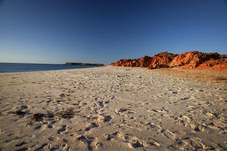 Western Australia rocky coastline with red colored rocks at Dampier Peninsula