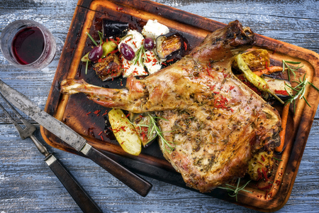 Barbecue Lamb Shoulder with Vegetables and Feta as top view on cutting board Stok Fotoğraf - 81545429