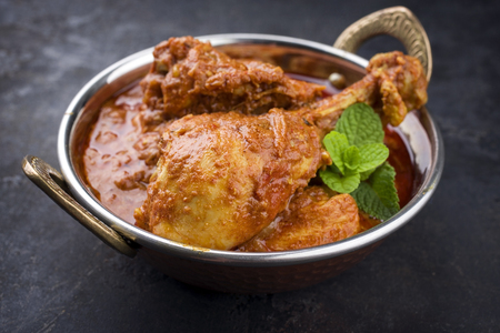 Traditional Indian Chicken Tikka Masala as close-up in a Korai