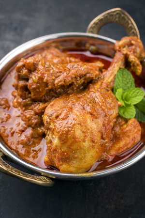 indian chicken curry madras in copper bowl