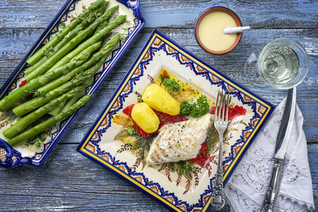 Codfish fillet with green asparagus and boiled potatoes as top-view on a plate Stock fotó - 84348456
