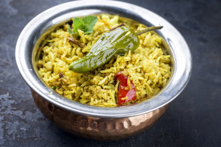 Indian Vegetable Biryani with sweet peppers as close-up in a frying pan