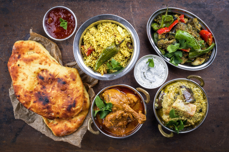 Traditional Indian Curries and Biryani with mango Chutney and Pita Bread as top view