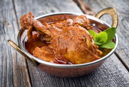 Traditional Indian Chicken Tikka Masala as close-up in a Korai Foto de archivo