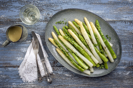 Boiled green and white Asparagus on a plate