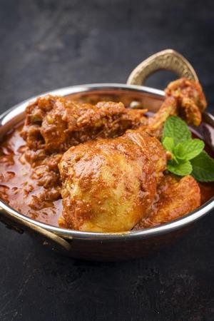Traditional Indian Chicken Tikka Masala as close-up in a Korai Stock Photo