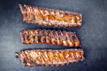 Barbecue Pork Spare Ribs on a black slate slab Stock Photo