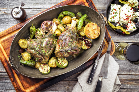 Barbecue leg of lamb with vegetable, potatoes and feta in a casserole Stock fotó