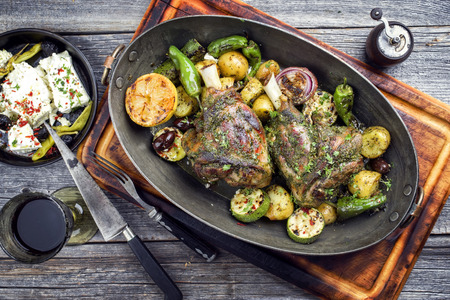 Barbecue leg of lamb with vegetable, potatoes and feta in a casserole Stock Photo