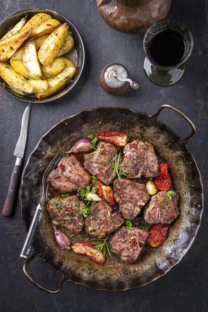 Barbecue T-bone lamb steak with fried potatoes and seasonings