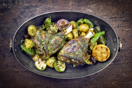 Barbecue leg of lamb with vegetable and potatoes Stock Photo