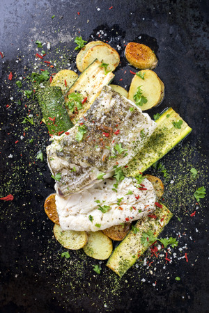 Fried cod fish fillet with vegetable and potatoes