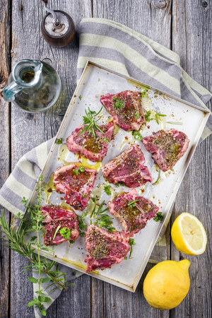 Raw T-Bone Lamb Steak with Seasonings Stock Photo