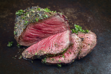 Barbecue Wagyu Point Steak sliced ??as close-up on an old rusty metal sheet Stock Photo