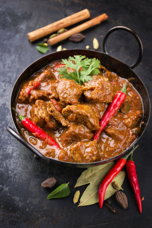 Traditional Indian curry lamb masala as close-up in a Korai 스톡 콘텐츠