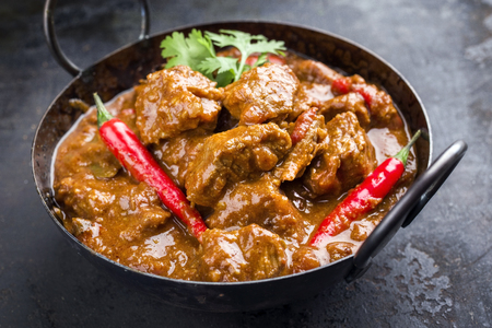 Traditional Indian curry lamb masala as close-up in a Korai Zdjęcie Seryjne