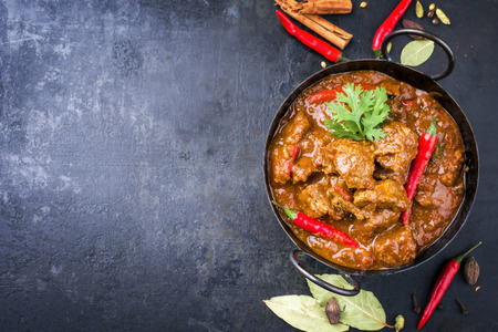 Traditional Indian curry lamb masala as close-up in a Korai Stock Photo