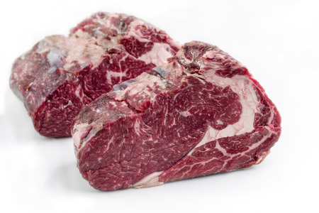 Two Raw dry aged Kobe rib eye Steak as close-up – covered