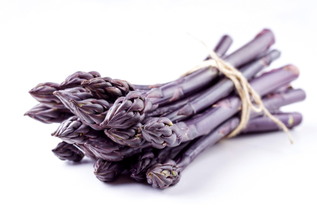 Row purple Asparagus as close-up with copy space � covered  Фото со стока