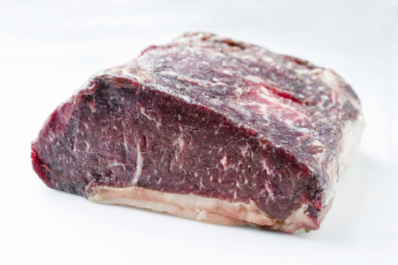 Raw dry aged Kobe roast beef as close-up – covered