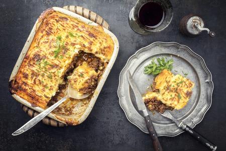 English shepherds pie as top-view on a pewter plate and backing dish  Stock Photo