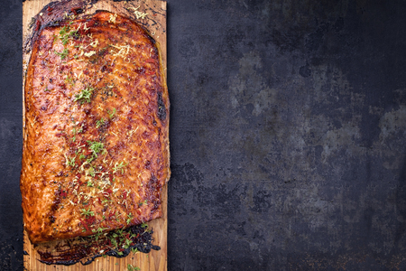 Barbecue salmon fillet marinated on cedar plank wood as top view with copy space right Stock Photo