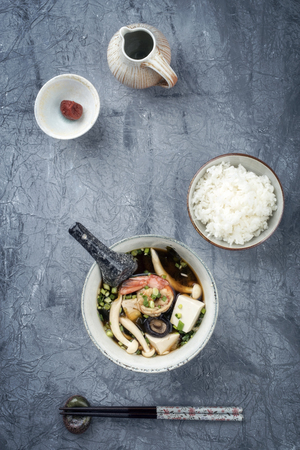 Traditional Japanese miso soup with king prawns and rice as top view in a bowl with copy space Stock Photo - 105595241