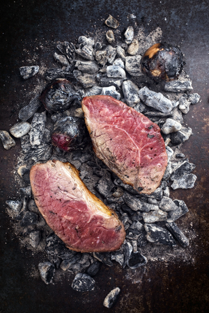 Barbecue caveman wagyu roast beef as top view on charcoal Stok Fotoğraf - 105530994