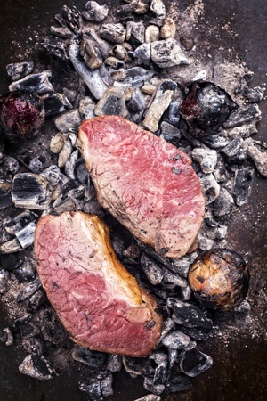 Barbecue caveman wagyu roast beef as top view on charcoal Stok Fotoğraf - 105530943