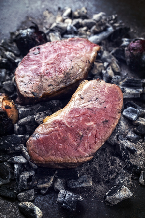 Barbecue caveman wagyu roast beef as top view on charcoal Stok Fotoğraf - 105530374