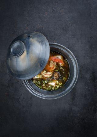 Traditional Japanese miso soup with king prawns and tofu as top view in a bowl with copy space Stock Photo