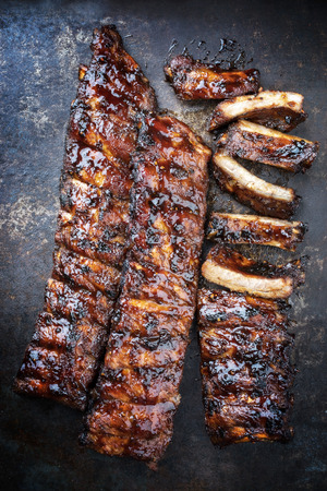 Barbecue spare ribs St Louis cut with hot honey chili marinade as top view on a rusty board Stock fotó - 112275241
