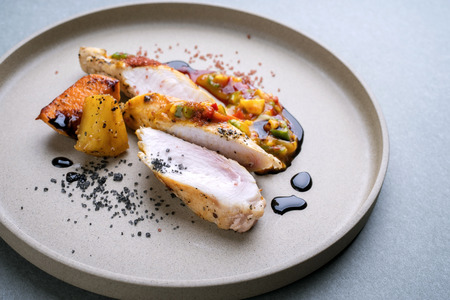 Modern barbecue crocodile tail eye fillet with roasted sweet potatoes pineapples and mango chili chutney as top view on a plate Reklamní fotografie