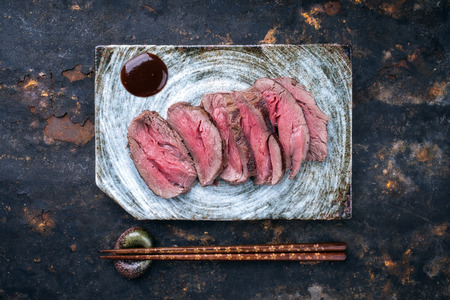 Japanese barbecue wagyu aged fillet steak slices as top view on a plate with copy space Stok Fotoğraf