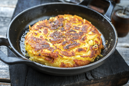 Traditional Swiss hash browns as side dish as closeup in a frying pan
