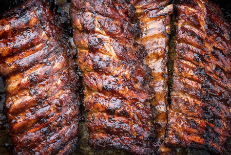 Barbecue spare ribs St Louis cut with hot honey chili marinade as top view copy space and food texture Reklamní fotografie