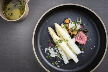 Modern Style classic white asparagus with barbecue dry aged sliced beef fillet and vegetable served on a  plate Stok Fotoğraf