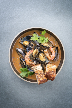 Traditional French Corsican seafood stew with prawns and mussels as top view in a modern design bowl with copy space Stock Photo