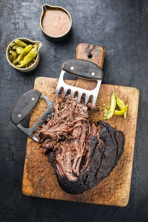 Traditional barbecue wagyu pulled beef with coleslaw as top view on a rustic cutting board 스톡 콘텐츠