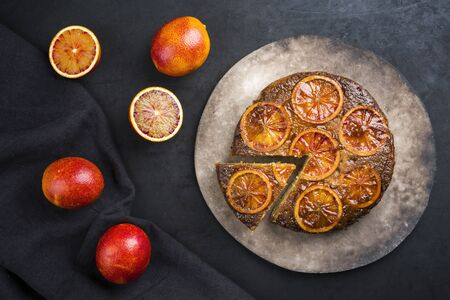 Traditional American upside-down bloody orange cake offered as top view on a modern design plate