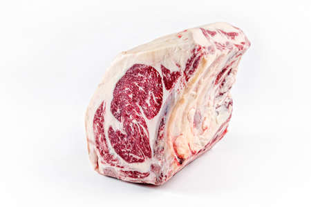 Raw dry aged wagyu cote de boeuf beef block as closeup on white background with copy space – free-from select