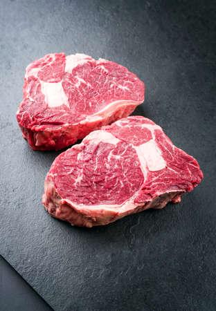 Raw dry aged wagyu Rib-Eye beef steak as closeup on a black background with copy space Stockfoto