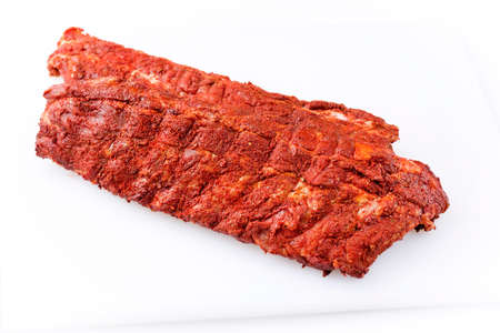Raw pork spare loin ribs St Louis cut with spicy rub offered as closeup on white background with copy space free-from select Stockfoto