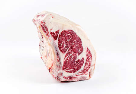 "Raw dry aged wagyu cote de boeuf beef block as closeup on white background with copy space a€"" free-from select"