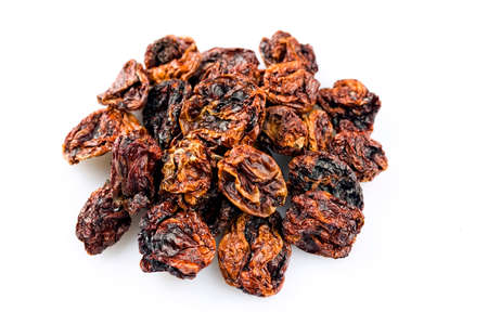 Dried Mexican hot Chile habanero seco chili offered as close-up on white background with copy space - free-form select