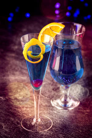 Traditional cocktail volcano with blue curacao and campaign offered as close-up in design glasses Фото со стока