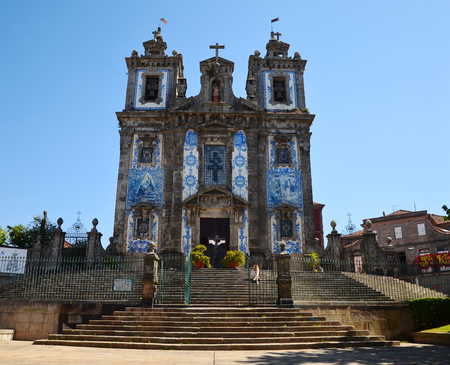 Igreja de Santo Ildefonso, Porto, Portugal - 2nd of May, 2017: Facade with Azulejos of the Church of Saint Ildefonso with blue sky