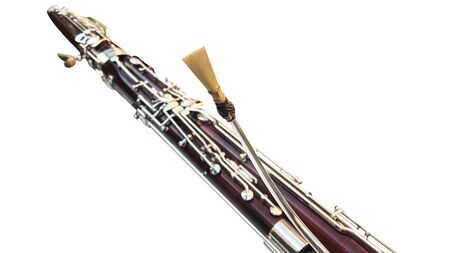 Part of a musical wind instrument on a white background. Double tongue. Bassoon.